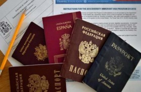 لهذا السبب عليك أن تبتسم في جواز السفر