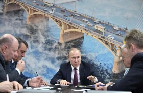 بوتين يخوض حملته الانتخابية بالحد الأدنى